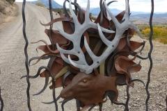 gate-elk-and-sun-detail-aluminum-rust